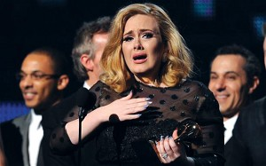 Adele accepting her award.