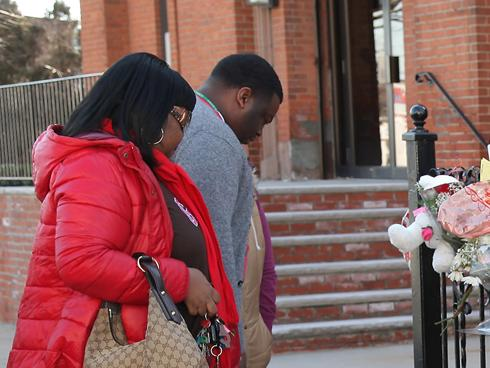 People look at a makeshift memorial outside The New Hope Baptist Church on Monday in Newark.
